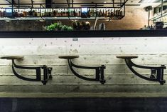 Fantastic installation of INDY Swing Arm Stools fitted to a bar at Trick Pony in Dallas, Texas, USA. Shown here with the castings in clear lacquer with turned ash waxed timber seats. Great lighting on the underside of the bar. Texas Usa, Dallas Texas, Bar Seating, Industrial Furniture, Restaurant Bar, Space Saving, Bar Stools, Ash, Pony