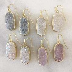Earrings In Style The Danay earrings from Kendra Scott feature a gorgeous iridescent crystallized drusy stone outlined by a gold metal frame. Cute Jewelry, Gold Jewelry, Jewelry Box, Jewelry Accessories, Jewlery, Wedding Jewelry, Druzy Jewelry, Bling Bling, Gold Drop Earrings