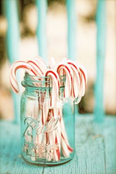 It is a family tradition to put candy canes on the tree. This year it will work perfectly with the red, white and turquoise tree.