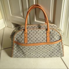 Authentic LV monogram Marie blue This is Authentic dr bag style Louis Vuitton bag. I kept it in my closet too long and not a great condition anymore.... Sad!! Outside look fine (although small stains appeared but just a few) but some powderish stuff are coming out from inside. Hard to explain but my guess is lining is messed up and coming out. Anyway, not great condition but still a LV and cute.:) please ask any questions before you decide to purchase!!! Louis Vuitton Bags Totes
