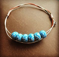 Upcycled Violin String Bangle With Light Blue Beads