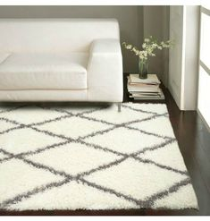 """I know that rug feels nice under your feet! And the little """"end table"""" is so clean and perfect with the decor. 