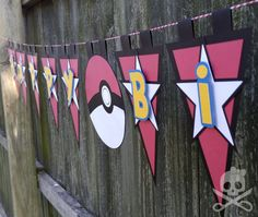 Gotta catch em all! This 100% handmade pennant banner is made of cut and layered cardstock strung on white and red twisted twine. It measures about 80 inches wide if spaced like in the photos but the twine is 4 yards long so that the pennants can be spread out to cover a wider space.   **Please note: paper banners are not recommended for outdoor use and photos of banners in packaging should not be used for color matching