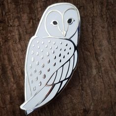 Our Barn Owl pin in a white enamel variant plated with a bright nickel finish and backed with two metal clutches to prevent spinning and for stabil...