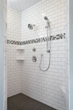 """Walls: Soho Glossy White 3x6 Subway tile; Accent: Glacier Peak 1""""x1""""; Shower floor: Inline Mosaics in color Smoke"""