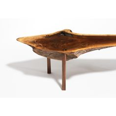Conceived by Paul White and Dan Morgan, this table is made from a single piece of walnut with a live edge. The legs are attached via a mortise-and-tenon joint technique; a sliver of maple in the dowel is visible on the table surface. The table's inception began with creating a proper table for sushi for two, sitting on the floor in the Japanese style.