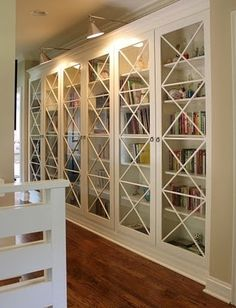 """You can also use some cheap Billy bookcases from Ikea and buy moulding that you can add to the top and to some to create that X pattern on the doors. Very stylish and the """"Billy"""" feel disappears. by maria.t.rogers"""