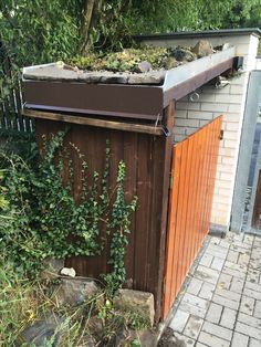 wheelie bin storage cabinet with touch less opener, green roof and wooden eaves