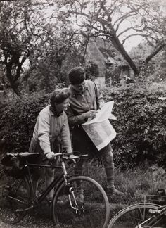 Creator:    Saidman  Date:    c. 1936  Description:    A photograph of two cyclists studying a map, taken around 1936 by Saidman for the Daily Herald.    The picture was taken to illustrate a story about a Youth Hostel in Ewhurst, Surrey. The Youth Hostels Association of Great Britain was formed in 1930. The Youth Hostel in Ewhurst ran from 1936 to 1983.