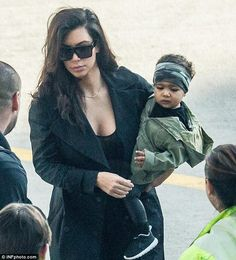 Just like daddy! Kim and Kanye's daughter North was dressed in camouflage bandana and matching jacket as the family jetted out of Sydney on Monday morning