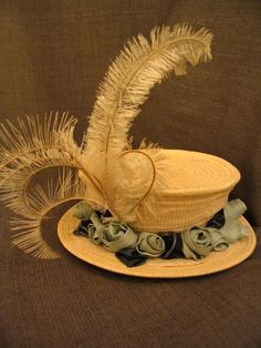 1900s Straw Hat with green fabric flowers.