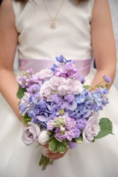 I like the shape of this bouquet, but i would swap out roses for white ranunclus. Gorgeous lavender and light blue bridal bouquet featuring roses, delphinium, and hydrangea.