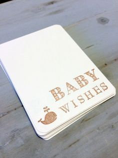 Guest Book: wish tags for guests to sign and then we make them into a book for the couple