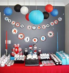 Star Wars birthday party decoration--I love the idea of using  a paper lantern as a death star