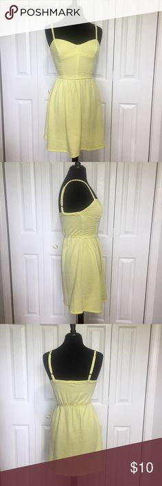 BeBop yellow Polk-a-dot sundress This little dress has a raised texture and feels really spongy. Look at pictures. Seems like something that would make a great swim cover. In good condition without rips or stains. Straps are adjustable and fabric is very stretchy. Measurements taken flat and in inches. Armpit to armpit 14 1/2. Waist 12 1/2 not stretched. Waist to hem 17. Center front to waist 7 3/4. Center back to hem 24. BeBop Swim Coverups