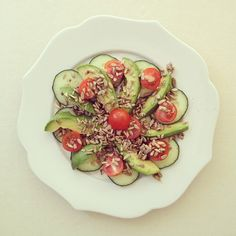 lunch : avocado . cherry tomato . cucumber w/ sprouted raw sunflower seeds