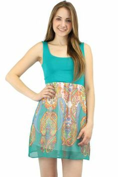 Stay cool in this blue flowy dress featuring a mirror affect pattern.