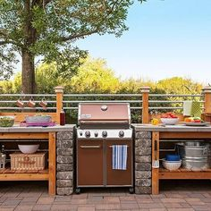 Get the look of an expensive outdoor kitchen without the cost. Surround a gas grill with a modular DIY structure that you can customize. Relaxing Outdoor Kitchen Ideas for Happy Cooking & Lively Party Outdoor Grill Area, Outdoor Grill Station, Outdoor Kitchen Patio, Outdoor Kitchen Design, Backyard Patio, Outdoor Living, Outdoor Kitchens, Patio Grill, Outdoor Grilling