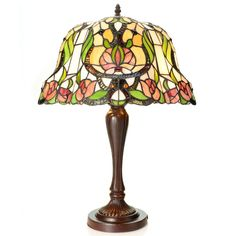 This beautiful Tiffany-style piece contains hand-cut pieces of stained glass, each wrapped in fine copper foil. Light up your living room or bed room with this gorgeous orchid flower inspired floor lamp.