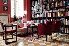 Italian public relations guru Roberto Begnini resides in one of Rome's most storied palazzo. In his living room, the pair of armchairs came from the Teatro di San Carlo in Naples, the red-leather chair is from the 1930s, and the sofa is covered with a Tunisian cotton blanket; the bookcase is custom made, and the antique rug is Iranian. Tour the rest of the home.   - TownandCountryMag.com