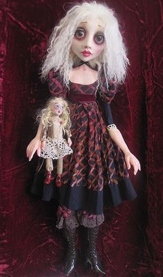 The dolls, sculptures and art of Sheri DeBow is worth perusing in her Flickr album