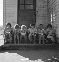 Girls of Lincoln Bench School study their reading lesson, Oregon, 1939 (Dorothea Lange)