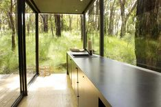 Dramatic Dark Red Hill Residence Displaying a Glass Skin - https://freshome.com/2012/01/10/dramatic-dark-red-hill-residence-displaying-a-glass-skin/