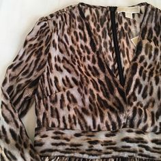 Michael Kors Leopard Dress with Empire Waist Michael Kors Leapord Empire Waist Dress with Gold Metallic thread. NWT. Zipper down the back. Price is Firm Unless Bundled. 10% Off 2 Item 15% Off 3 Items or More Michael Kors Dresses Long Sleeve