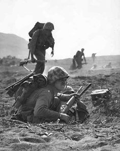 A carbine-equipped US Marine on Iwo Jima, Feb 1945; note M8 grenade launcher attached to the muzzle of the weapon