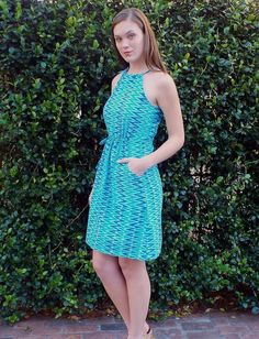 Pacific Waves Dress from Passion Lilie. The prefect slip on dress for the warm weather. Made with a super soft hand woven cotton in all the best shades of blue, adjustable ties at the neck, a drawstring waistband and front pockets! Fair trade.