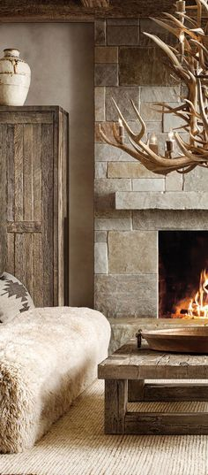 A snowy retreat in the mountains should be cozy and inviting, with a roaring fire, earth tone colors, plush fabrics, and unique artwork. The best way to achieve this is by layering textures. Think upholstery, area rugs, throw pillows, blankets, and window treatments. All of these components add up to creating a room that you'd like to curl up in and relax. #mountainhomes #modernmountainhomes #rusticdesign #rusticinteriors #mountainlivingroom #decoratingideas #homedecor
