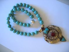 ANTIQUE TIBETAN SILVER PENDANT with SACRED IBIS and INLAID Carnelian ... On TURQUOISE BEADS NECKLACE