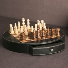 Leather Chess Board | Strategize your next move in handsome fashion. This leather-clad chess board features wood pieces with a vintage feel.