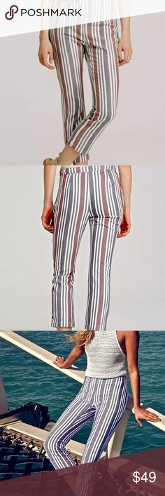 """FREE PEOPLE Vertical Striped Cropped PantsNWOT 12 FREE PEOPLE Multi-Color Vertical Striped Cropped PantsNWOT Women'sSz 12 •DETAILS: *Cropped & Streamlined w/ Slimming Vertical Stripes! *Mid Rise w/ a Banded Waist & Discreet Side Zip Closure. *Slim Fit through hips & thighs.  *Straight Leg Silhouette. •MEASUREMENTS: Length- 38.5""""; Waist- 34""""; Rise- 11.5""""; Inseam- 26.5"""" •MATERIAL:  55% Linen, 42% Cotton, 3% Spandex •CARE: Hand Wash Cold **SMOKE-FREE & PET-FREE HOME!** Free People Pants…"""