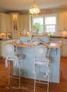 Beautiful and comfy looking. The island was painted Yarmouth Blue and then the house owner did some light distressing. The colours are lovely and so calm and restful. The wainscot and the island look so soft and make a nice backdrop for the china.                                                                                                                                                     More