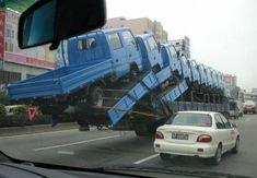 Trucks upon trucks upon trucks in China (wouldn't want to be following that truck of trucks...)