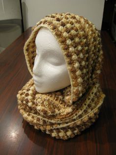 Crochet tutorial that teaches you how to crochet an infinity scarf using the butterfly stitch and a puff stitch mix. You can find the Written pattern here ht...