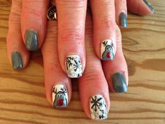 Blue gray reindeer and overlapped snowflakes