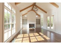 Currey & Co. light fixture, vaulted/beamed ceilings, chevron pattern in bookcases.  Keeping room off kitchen.