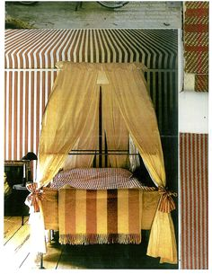 More stripes! This is such a great canopy bed. Especially love the not-too-sweet bows.