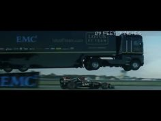 Epic World-Record Truck Jump by EMC and Lotus F1 Team: A tractor trailer driven by expert stuntman Mike Ryan jumped 83 feet and 7 inches over a Formula F1 car driven by Martin Ivanov