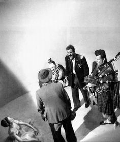 """""""Clown, hobo, ballet dancer, bagpiper, and an army major - Scene from a taping of an episode of the Twilight Zone: a collection of question marks. Five improbable entities stuck together into a pit of darkness. No logic, no reason, no explanation; just a prolonged nightmare in which fear, loneliness and the unexplainable walk hand in hand through the shadows.    In a moment we'll start collecting clues as to the whys, the whats and the wheres. We will not end the nightmare, we'll only…"""