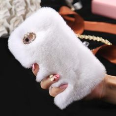 """Compatible iPhone Model: iPhone 7 Plus,iPhone 6 Plus,iPhone 6s,iPhone 5s,iPhone 6s plus,iPhone 6,iPhone SE,iPhone 5,iPhone 7 Retail Package: Yes Design: Plain,Exotic,Animal,Vintage,Geometric,Cute,Abstract Type: Half-wrapped Case Function: Dirt-resistant Features: Real Rabbit Fur Hair Diamond Case Phone Accessories Size: 4.0"""" 4.7"""" 5.1"""" 5.5"""" For iPhone 5 5S SE 6 6S 7 Plus For Galaxy S6 S7 Compatible Brand: Apple iPhones Brand Name: KISSCASE Color: Black White Grey Hot pink Pink Purple Blue…"""