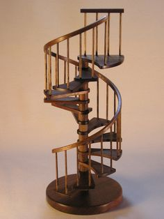 1/12th scale, 9 inch walnut spiral staircase.. $189.00, via Etsy.