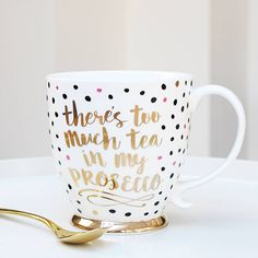 """There's too much tea in my prosecco mugFor a mug less ordinary you will love our gold porcelain prosecco mug With its fabulous and pretty gold trim and polka dot design this is going to be your new favourite mug! With its quirky and fun design reading """"There's Too Much Tea In My Prosecco"""" it also makes the perfect gift for family and friends An ideal stocking filler this Christmas *The gold spoon is not includedPorcelain Mug: Height: 10.5 cm Width: 14 cm Dia: 10 cm Gold Cuttlery (available…"""