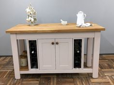Useful storage & display are combined in this island design. It incorporates a double cupboard flanked by wine storage racks, 2 end cutlery drawers, an oak slatted display shelf plus a long breakfast bar along one side. Shown here finished in Farrow & Ball Peignoir Estate Eggshell finish & in an overll size of L:1600mm D:900mm H:910mm but any size or colour is available to order. Painted Kitchen Island, Kitchen Islands, Wine Rack Storage, Cupboard, Cabinet, Freestanding Kitchen, Island Design, Eggshell, Farrow Ball