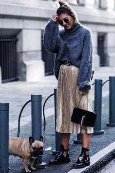 A chunky turtleneck sweater looks cool with a metallic pleated skirt.