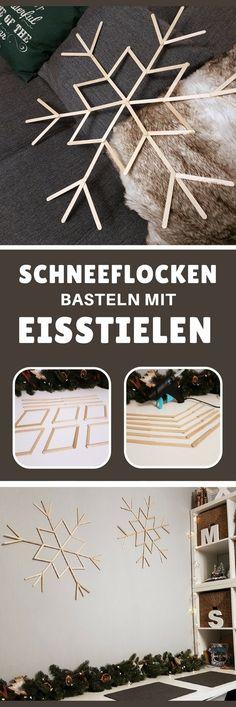 Schneeflocken basteln mit Eisstielen: XXL Winter-Wanddeko