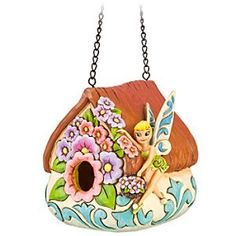 Disney Tinker Bell Birdhouse by Jim Shore | Disney StoreTinker Bell Birdhouse by Jim Shore - Hang up a garden home for your feathered friends with our Tinker Bell Birdhouse by Jim Shore. A sculptured cottage with folk art filigree offers shelter and a place to feed your favorite birds (and perhaps a passing pixie on her flight to Never Land).