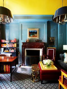 Traditional Living Room With Blue Walls and a Yellow Ceiling & Moodier Hues of Mahogany & Burgundy